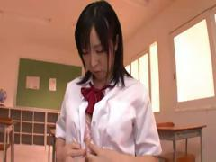 Japanese schoolgirl toys her pussy and gets help doing it
