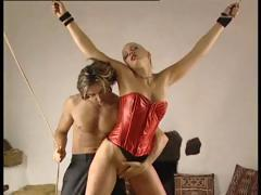Tied bitch can't do anything while her master is playing with her pussy