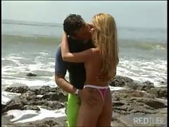 Surfer meets a girl on a rocky beach and bangs her right on the spot