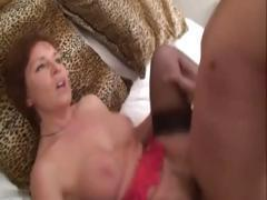 Mature slut in stockings lures her son's buddy into her bed
