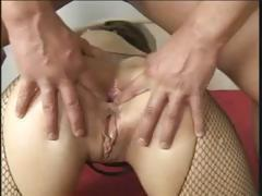 Brunette in crotchless nylons takes on three hard cocks to fuck