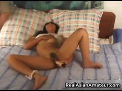 Asian nympho toying her hairy pussy part1
