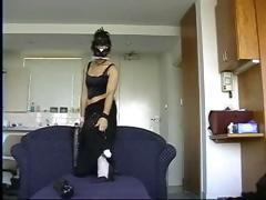 Brunette in a mask gets her ass busted with dildo and fist