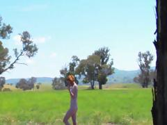 Redhead Isadora Pink is outside naked and strutting her stuff