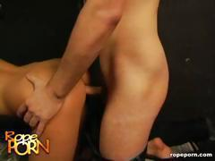 Hot brunette is tied up and this makes her hornier as she fucks
