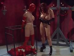 Busty babes and one masked as mistress tortures her slave
