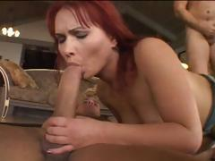 Sexy redhead babe takes on two cocks and gets a nice hard DP