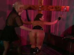 Busty brunette is tied up and the mistresses fight over who gets her