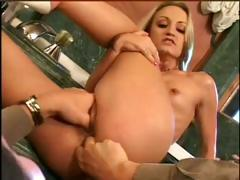 Blondie gets her ass fingered first and then lets a cock into it