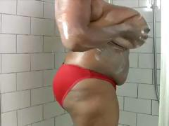 Chubby ebony ho washing her enormous milk jugs in the showers