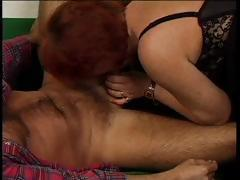 Red-haired oldie with huge jugs is here to get fucked raw