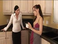 Brunette Sasha Grey fucks Ariel X with a strapon in this lesbian video
