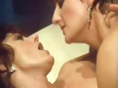 Sharon Mitchell in a lesbian scene in this old retro movie clip