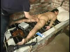 Brunette Loni is tied up and at the whim of her BDSM master