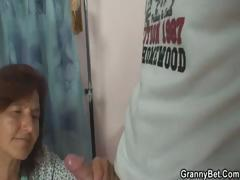 Granny stops her sewing long enough to fuck this young guy's cock