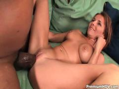 Cute brunette has ahold of a monster black cock and fucks it