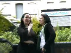 Two lesbians are in the public view and play around showing tits