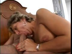 Busty mature lady sucks cock and gets her ass hammered hard