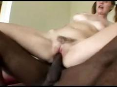 Pigtailed teen gets a monster black cock in both her fuck holes
