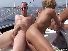 Group fuck outside on the boat with lots of hot pussy and sucking