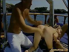 Busty blonde Tara White gets two hard cocks on the boat to fuck
