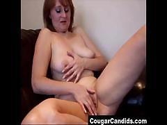 Old amateur MILF working her mature pussy at home on the couch