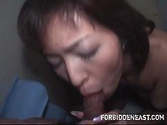 Hot Asian MILF is giving a blowjob in this nice POV webcam