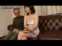 Japanese girl is given a cock to suck and she gets fucked on couch