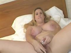 Big busty Cindy is at home in bed using a dildo to masturbate