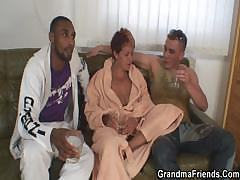 Dirty granny takes two big cocks