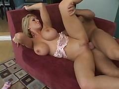 Busty Candy Manson gets fucked all over on her red couch and sucks