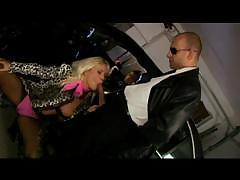 Hot blonde bitch sucks and fucks those two hard cocks in a car