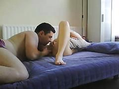 Couple on bed where he is into licking her pussy to orgasm