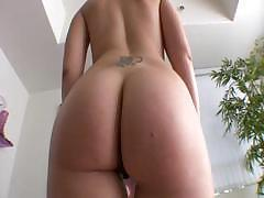 She shows off her ass and sucks on a black dick before fucking