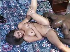 Babe is taking on a large black man's big hard cock in pussy