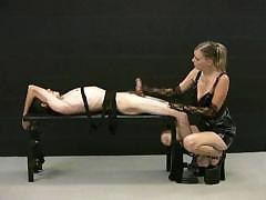 Blonde mistress jerks off her tied up slave and demands for more cum
