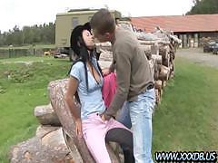 Angelica fucks and sucks her riding instructor on the wood pile