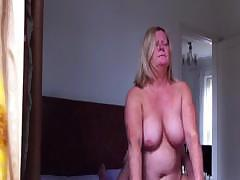 Chubby blonde is sitting on a hard dick and bouncing up and down