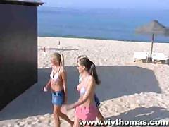 Hot beach babes are playing hit the pussy with each other