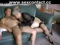 Big old granny sucks on a cock and then sits on it and fucks