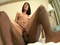 Kitty Wildwood sucks on a huge black cock to make it come on her