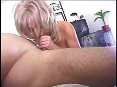 Blond babe with heavy tits can't wait to massage that big hard cock