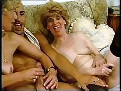 A retro porn scene with two grannies and a hung younger stud