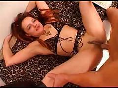 Redhead gags down on a stiff cock and takes it all the way up her pussy