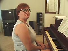 Plump piano teacher busted getting skewered with two cocks