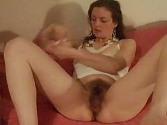 Nice hairy snatch is being played with for yours and  her pleasure