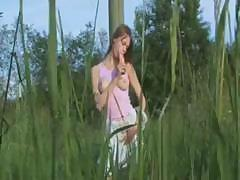 Teen has fun with her food in the great wide open outdoors
