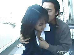 Asian couple like doing the fucking deed outside on a balcony