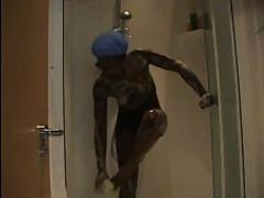 Lonely black chick takes shower and then masturbates impassionedly