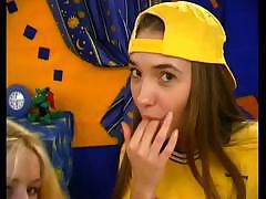 Slim college girl in yellow cap sucks dick in front of her girlfriend